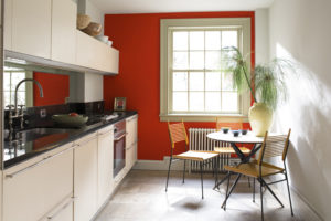 Red and Gray Kitchen with Black Counter