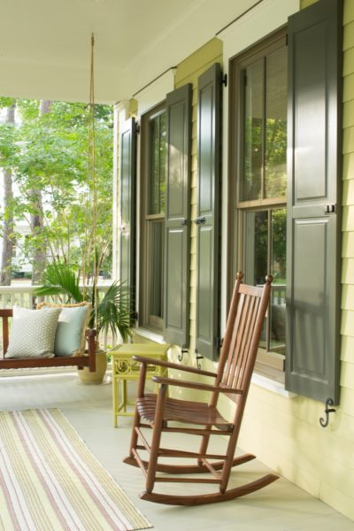 Green Porch with Dark Green Shutters
